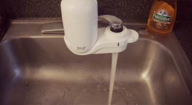 With everything from traces of arsenic, nitrates, to lead, to pharmaceutical drugs and copper, it's best to AT LEAST get a faucet filter for the water you consume. They are about 30 dollars and the filter will last about 3 months, also 30 dollars.
